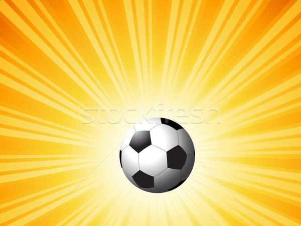 Football on starburst Stock photo © kjpargeter
