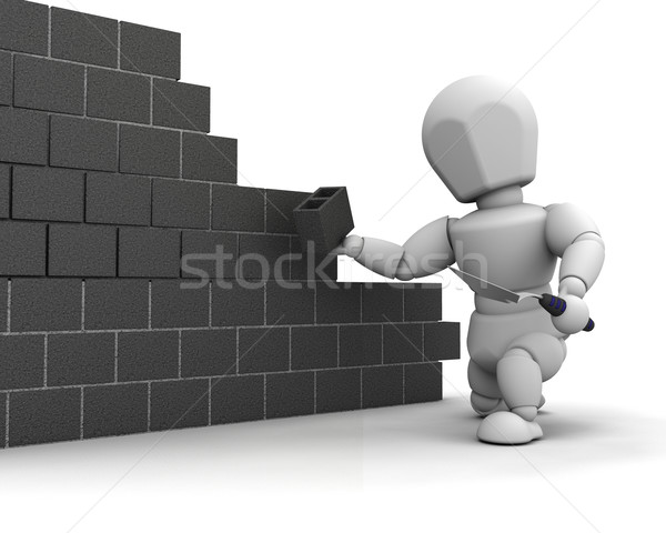 man laying blocks building a wall Stock photo © kjpargeter