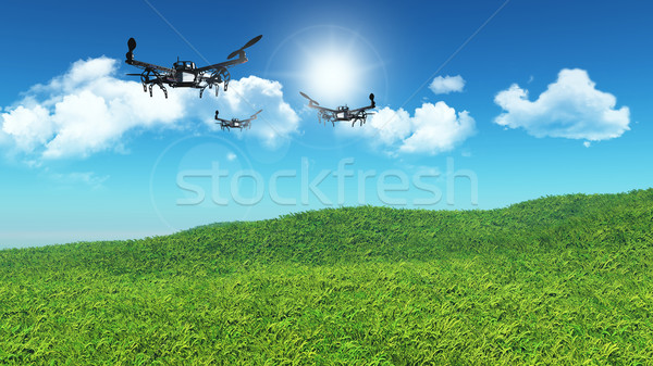 3D drones flying in a grassy landscape Stock photo © kjpargeter