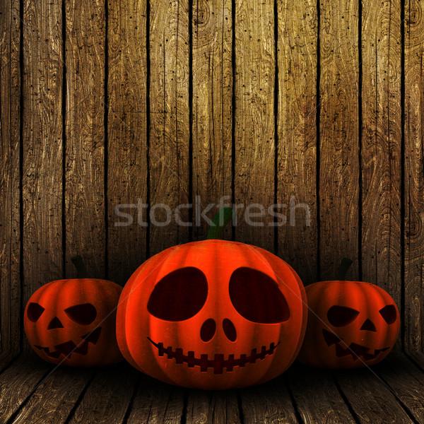 3D grunge Halloween jack o lanternS on a wooden background Stock photo © kjpargeter