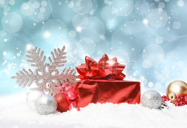 Christmas decorations on blue glittery background Stock photo © kjpargeter