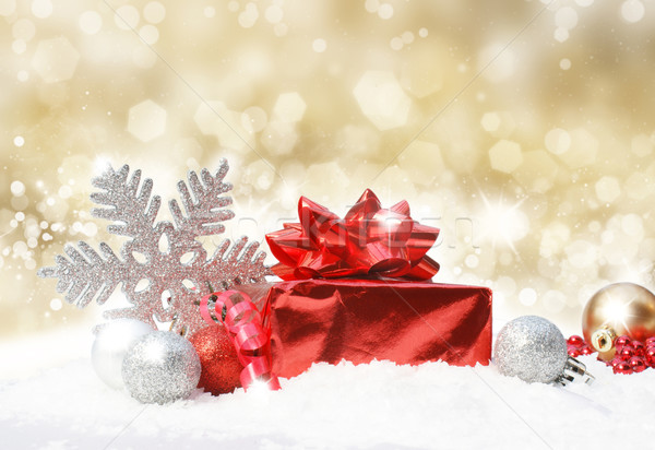 Christmas decorations on gold glittery background Stock photo © kjpargeter