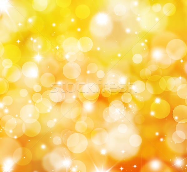 Glittery gold lights background Stock photo © kjpargeter