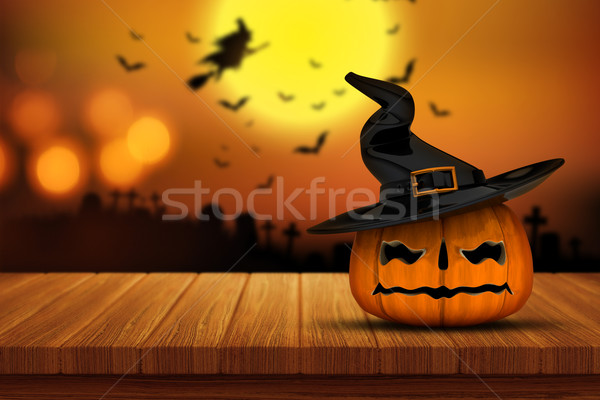 3D Halloween pumpkin on a wooden table with defocussed spooky im Stock photo © kjpargeter