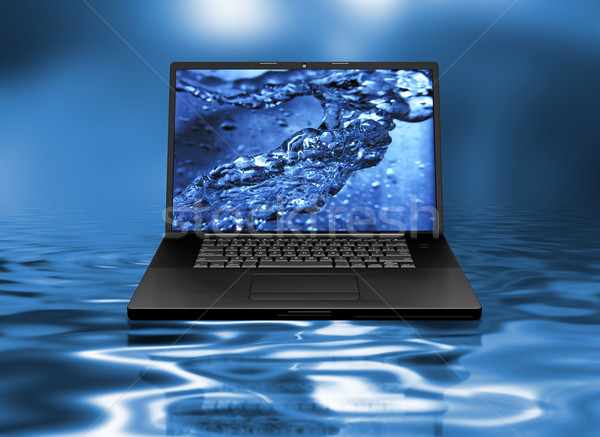 Laptop on water Stock photo © kjpargeter