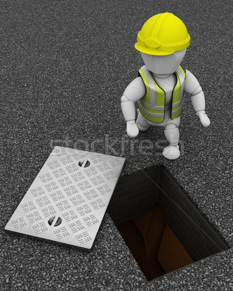 Builder inspecting drains through manhole cover Stock photo © kjpargeter