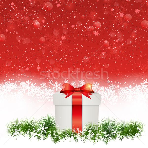 Christmas gift nestled in snow Stock photo © kjpargeter