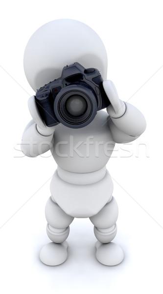 MAN USING CAMERA Stock photo © kjpargeter
