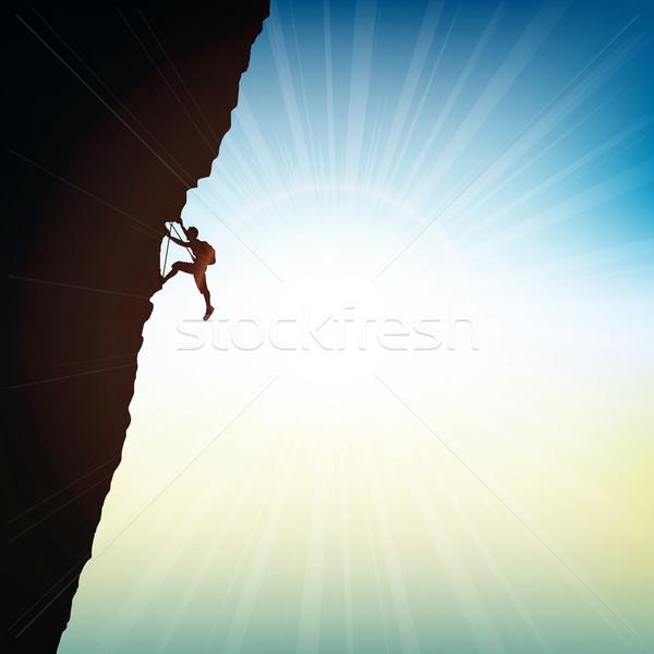 Aşırı kaya siluet güneşli gökyüzü adam Stok fotoğraf © kjpargeter