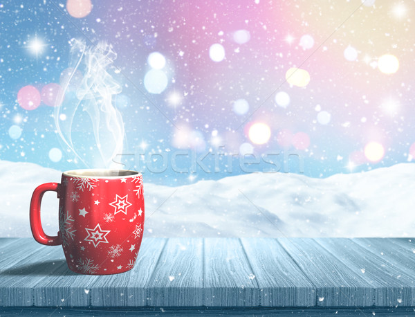 3D steaming Christmas mug on a wooden table against a snowy land Stock photo © kjpargeter