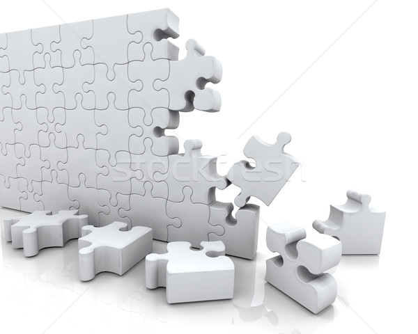 SOLVING JIGSAW PUZZLE Stock photo © kjpargeter
