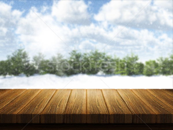 Wooden table with Christmas snowy landscape defocussed in the ba Stock photo © kjpargeter