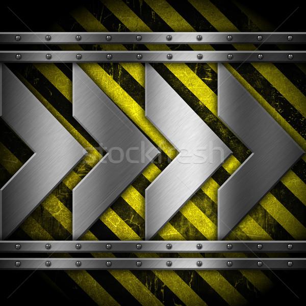 Metallic arrows on striped background Stock photo © kjpargeter