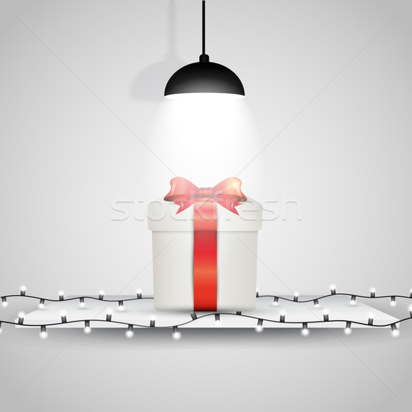 Christmas gift on display under a spotlight Stock photo © kjpargeter