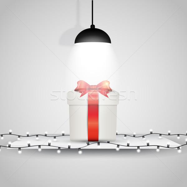 Рождества подарок отображения Spotlight шельфа свет Сток-фото © kjpargeter
