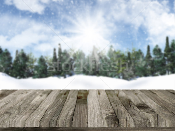 Wooden table with defocussed christmas snowy landscape in the ba Stock photo © kjpargeter