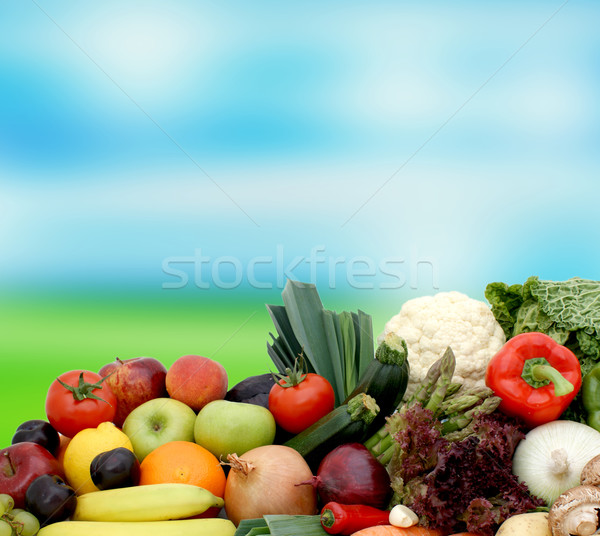 Fruit and vegetables on blurred background Stock photo © kjpargeter