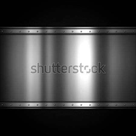 Shiny metal plate on a carbon fibre background Stock photo © kjpargeter