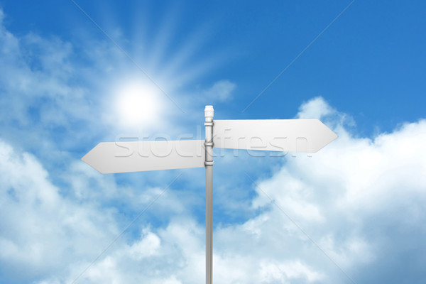 Signpost against blue sky Stock photo © kjpargeter