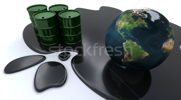 Oil drums and globe sat in spilt oil Stock photo © kjpargeter