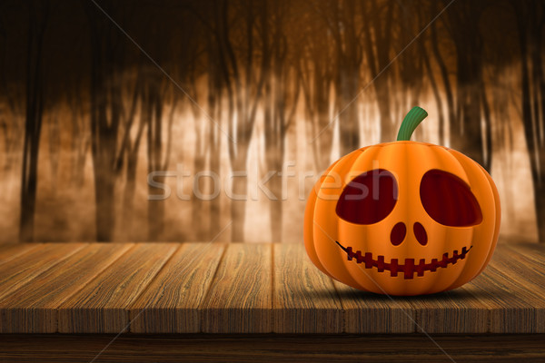 3D Halloween pumpkin on a wooden table with defocussed foggy for Stock photo © kjpargeter