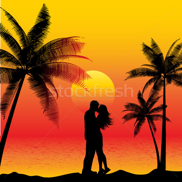 couple kissing on beach Stock photo © kjpargeter