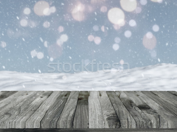 Wooden table with defocussed snowy landscape Stock photo © kjpargeter