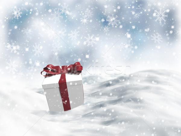 3D Christmas gift nestled in snow  Stock photo © kjpargeter