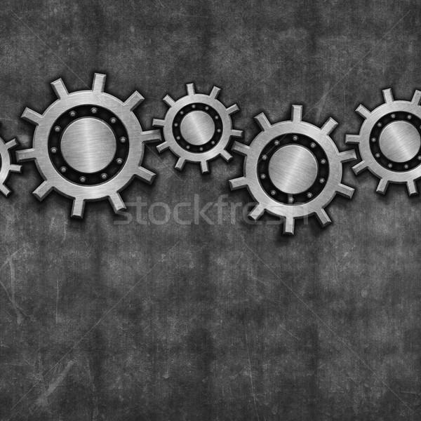Interlocking gears on grunge Stock photo © kjpargeter