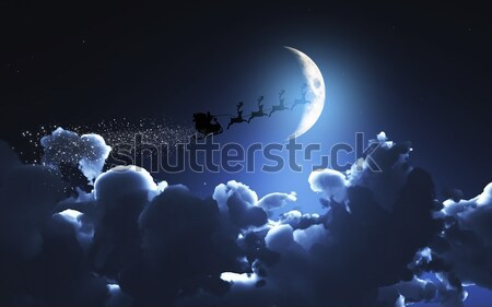Santa and his sleigh flying in a moonlit sky Stock photo © kjpargeter