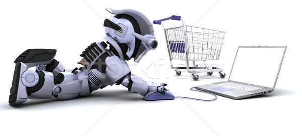 Robot shopping for gifts on a laptop Stock photo © kjpargeter