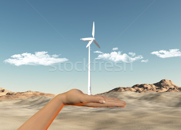 Hand holding wind turbine against a desert Stock photo © kjpargeter
