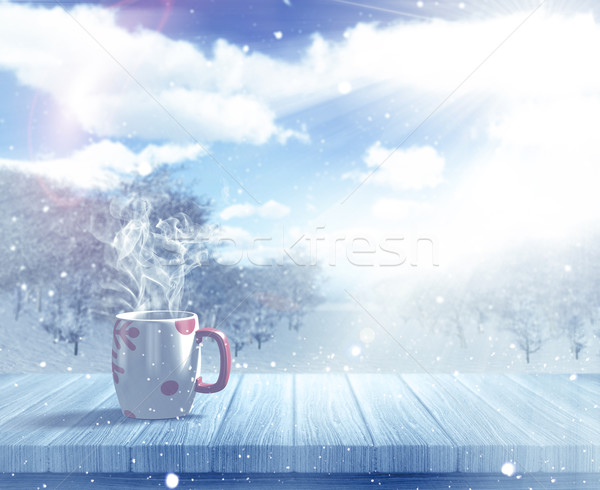 3D Christmas mug on a wooden table against a defocussed snowy la Stock photo © kjpargeter