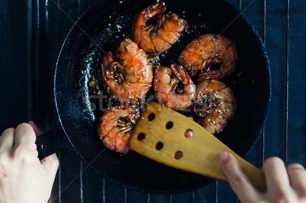 Shrimp fried with garlic and sesame seeds Stock photo © kkolosov