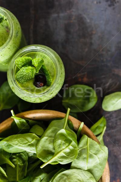 Smoothie vert jar banane épinards fraîches herbes Photo stock © kkolosov