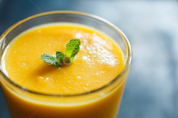 Orange smoothie verre menthe haut vue Photo stock © kkolosov