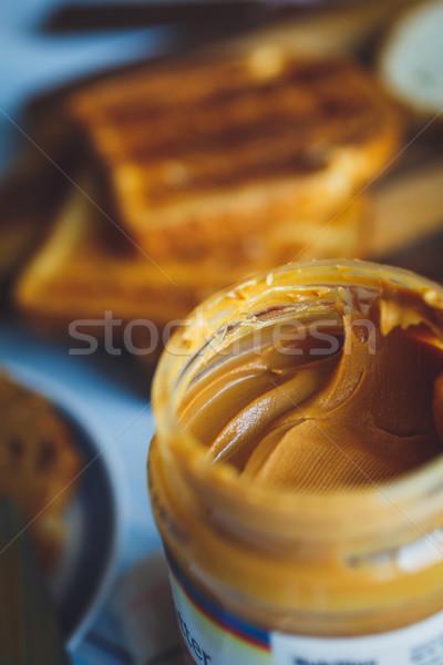 Ouvrir jar beurre d'arachide fond déjeuner blanche Photo stock © kkolosov