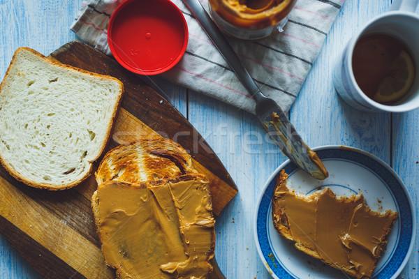 Beurre d'arachide sandwiches lumière bois alimentaire pain Photo stock © kkolosov