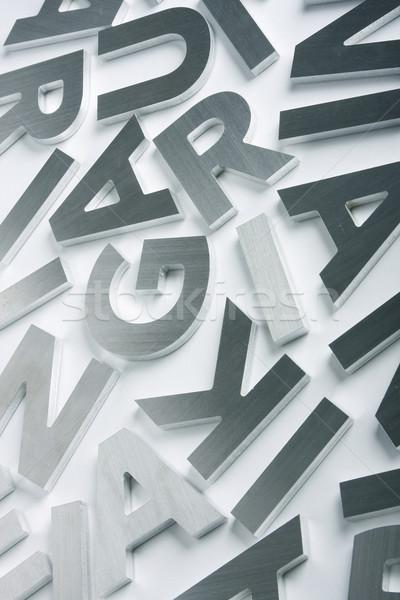 Ze stali nierdzewnej litery elegancki obyty stali Zdjęcia stock © klikk