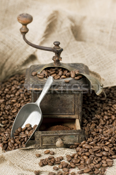 Old coffee grinder with coffee beans Stock photo © klikk