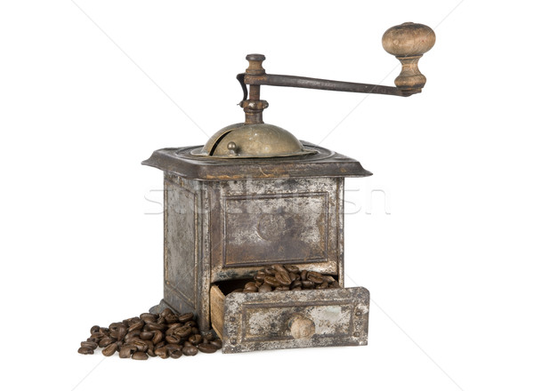 Old coffee grinder with coffee beans isolated Stock photo © klikk