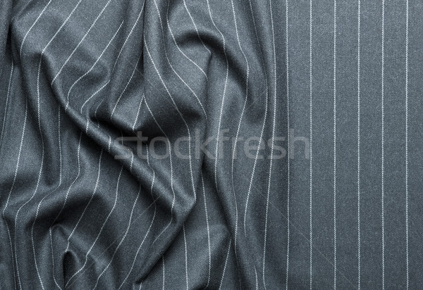 Pin striped suit with creases Stock photo © klikk