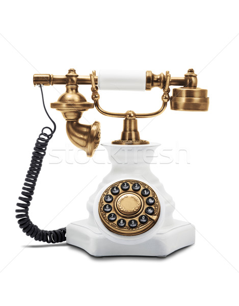 Vintage telephone on white Stock photo © klikk