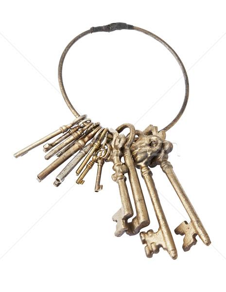 Old keychain with many keys isolated with path Stock photo © klikk