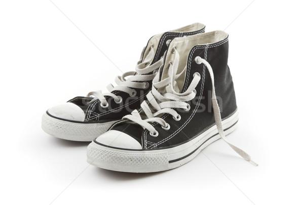 Pair of canvas sneakers isolated Stock photo © klikk
