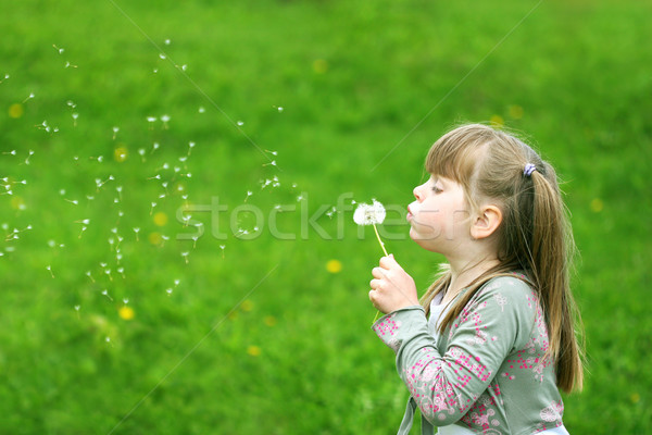 Stock photo: Girl playing with a flower