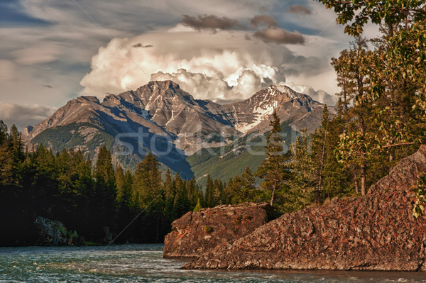 A storm gathers over the mountains at sunset in Banff - Canada. Stock photo © Klodien