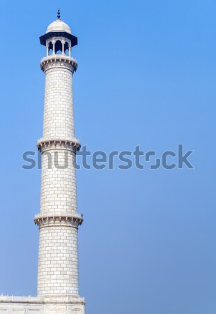 One of the four Taj Mahal minarets against blue sky in India's A Stock photo © Klodien