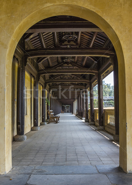 Vietnam Hué Citadel: long view into covered hallway with open side. Stock photo © Klodien