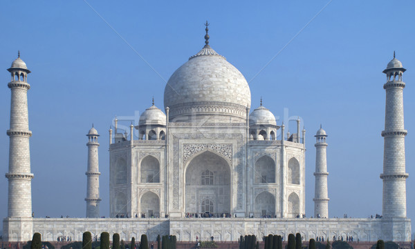 The white marble Taj Mahal mausoleum as a block against blue ski Stock photo © Klodien